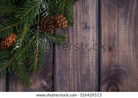wooden background with fir branches, top view - stock photo