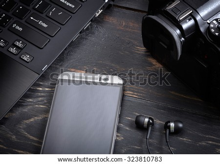 Wooden background with gadgets - stock photo
