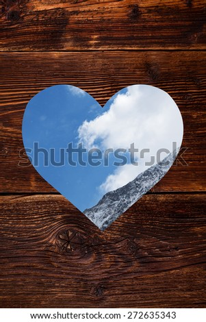 Wooden background with heart shape window with Austrian Alps in it. Traditional Austria. - stock photo