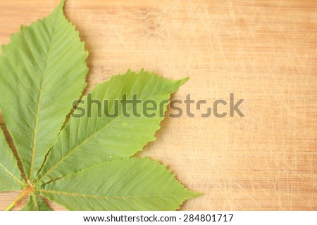 wooden background with leafs, shallow dof - stock photo