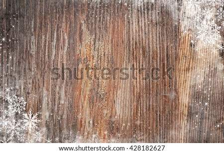 Wooden background with snow effect - stock photo