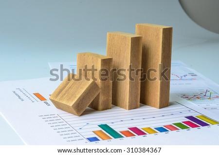 wooden bar graph on paper graph vintage ton - stock photo