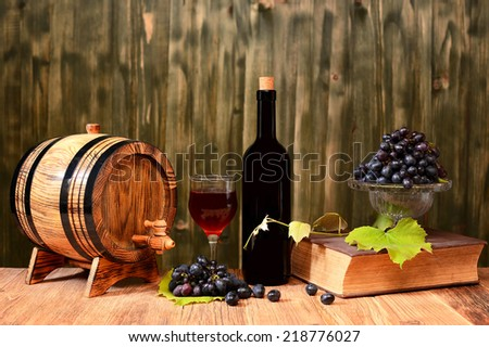 Wooden barrel, wine and fresh grapes - stock photo