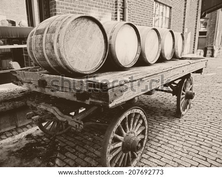 Wooden barrels on an old-fashioned cart - stock photo