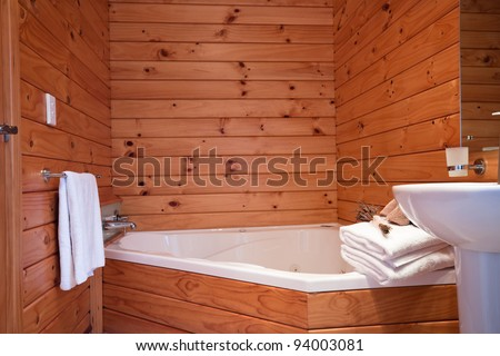 Wooden bathroom interior in mountain lodge apartment. Fox Glacier Lodge, Fox Glacier, West Coast, South Island, New Zealand. - stock photo