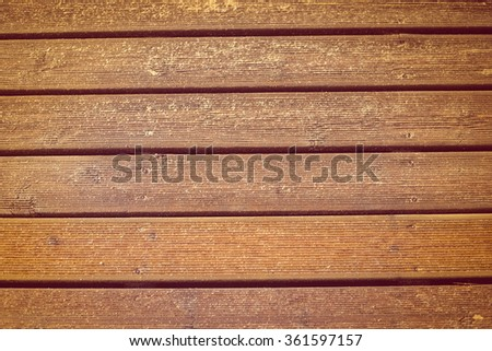 Wooden beach boardwalk with sand for texture or background  - stock photo
