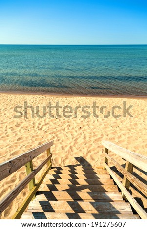 wooden beach steps access to the sea - stock photo