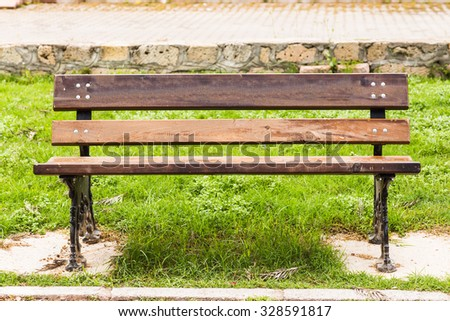 wooden bench at a park - stock photo