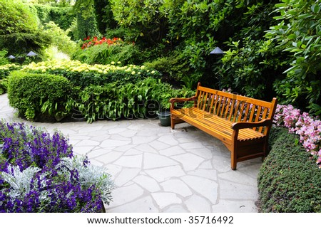 Wooden Bench found in Butchart Garden, Victoria Island, Canada - stock photo