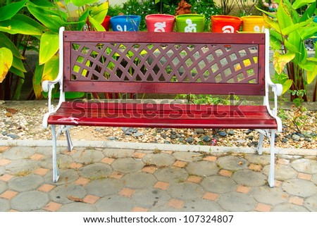 Wooden bench front green - stock photo