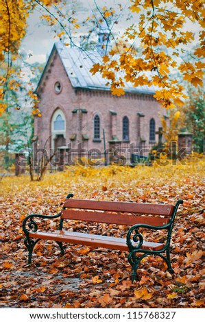 wooden bench in autumn park - stock photo