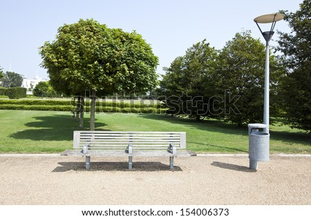 Wooden bench in London Park - stock photo