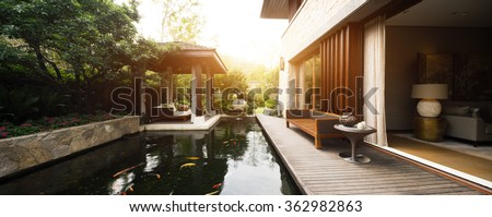 wooden bench on wooden floor in backyard with a pond - stock photo