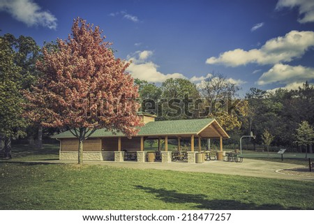 Wooden benches  in a park during the autumn season - stock photo