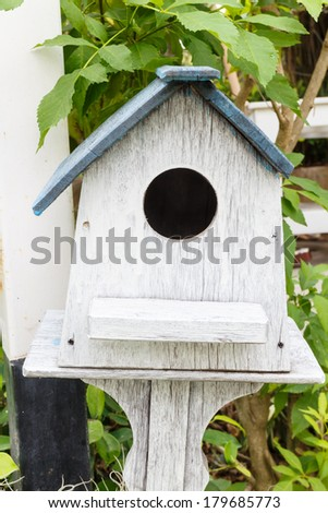 Wooden bird house - stock photo