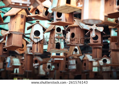wooden bird house as background. - stock photo