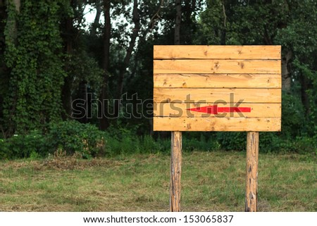 wooden blank sign with the nature background. you can put your text above the red arrow sign. copy and text space - stock photo