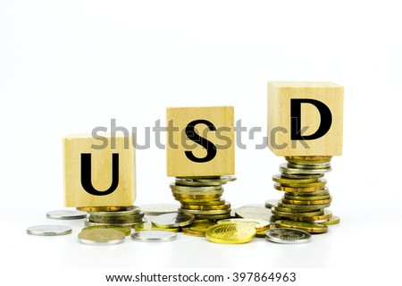 Wooden block with stacked coins with word USD (US Dollar) code - stock photo
