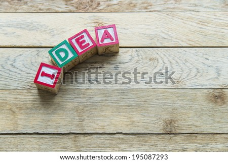Wooden blocks are Idea word on wooden floor - stock photo