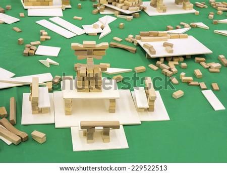 Wooden Blocks, children toy set on a green background - stock photo