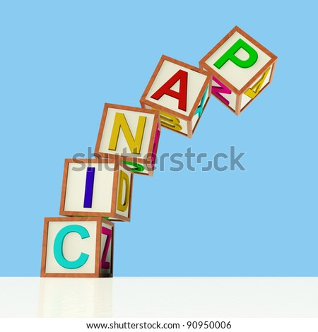 Wooden Blocks Spelling Panic Falling Over As Symbol for Emergency And Stress - stock photo