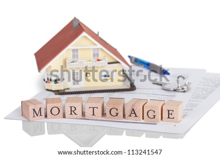 Wooden blocks spelling the word Mortgage on a legal document - stock photo