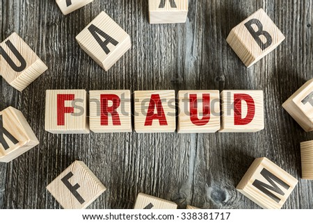 Wooden Blocks with the text: Fraud - stock photo