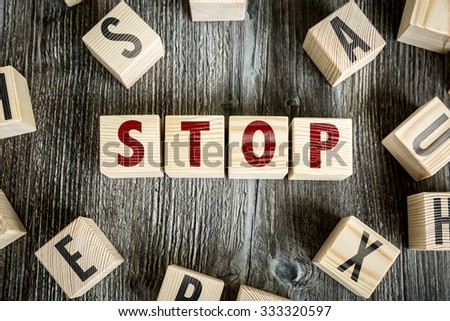 Wooden Blocks with the text: Stop - stock photo