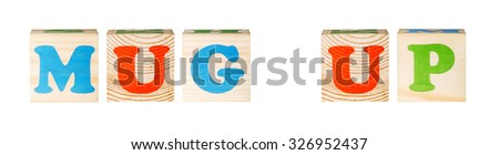 wooden blocks with the word mug-up isolated on a white background - stock photo