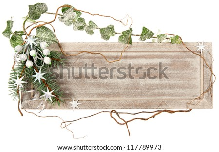 Wooden board decorated with ivy, spruce, stars and artificial berries - stock photo
