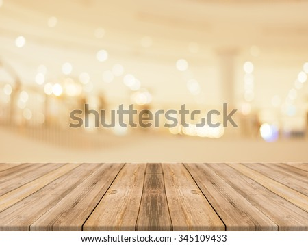 Wooden board empty table blurred background. Perspective brown wood over blur in department store - can be used for display or montage your products.Mock up for display of product. - stock photo
