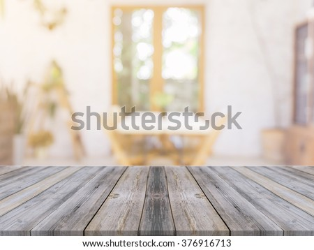 Wooden board empty table in front of blurred background. Perspective gray wood over blur in coffee shop - can be used for display or montage your products.Mock up for display of product. - stock photo