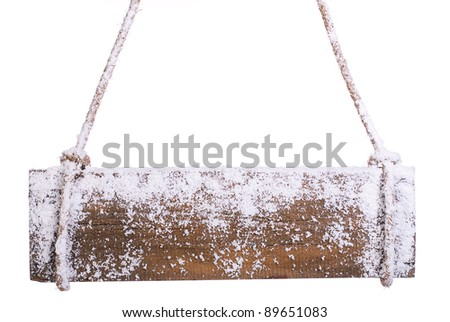 wooden board in the snow. on a white background - stock photo
