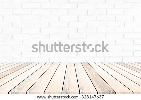 Wooden board on a background of white brick wall.Abstract style - stock photo