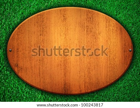 wooden board on grass - stock photo
