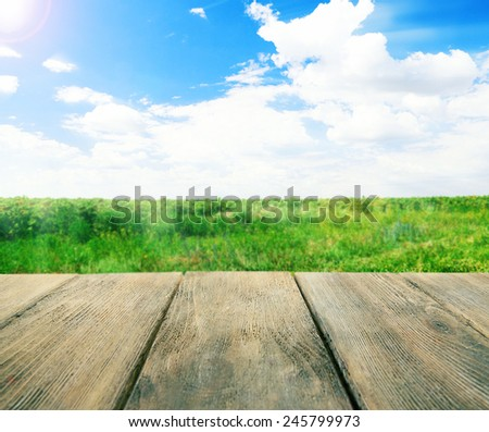 Wooden board on landscape background - stock photo