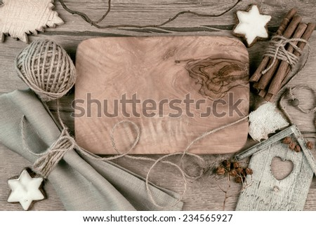 Wooden board with winter decorations around, space for your text - stock photo