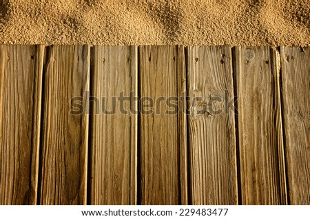 Wooden boards and sand, background - stock photo