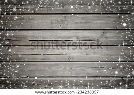 Wooden boards background with snow and stars - stock photo