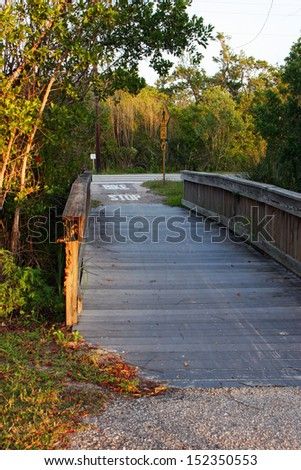 Wooden Boardwalk Bridge Ding Darling Sanibel Florida ; Bailey Tract - stock photo