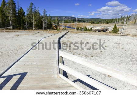 Wooden Boardwalks on the geothermal areas of Yellowstone National park, protect both visitors and the fragile volcanic environment of microorganisms that create the colorful mats near the hot springs - stock photo