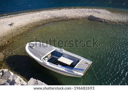 Wooden boat moored in protected cove on Brac island in Croatia - stock photo