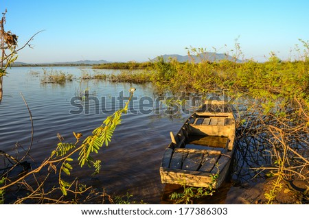 wooden boat on lake - stock photo