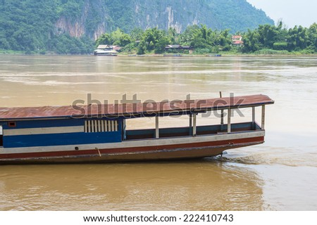 Wooden boat on the Mekong river in Asia - stock photo