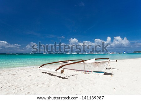 Wooden boat on tropical beach with white sand, Philippines, Boracay - stock photo