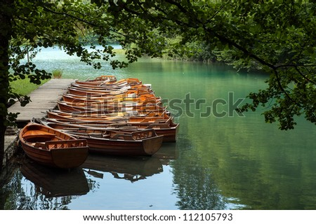 Wooden boats for hire, waiting for tourists in Plitvice Lakes National Park, Croatia - stock photo