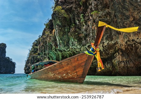 Wooden boats in the bay of a tropical island, Thailand - stock photo