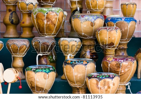 Wooden bongos in a traditional african shop - stock photo