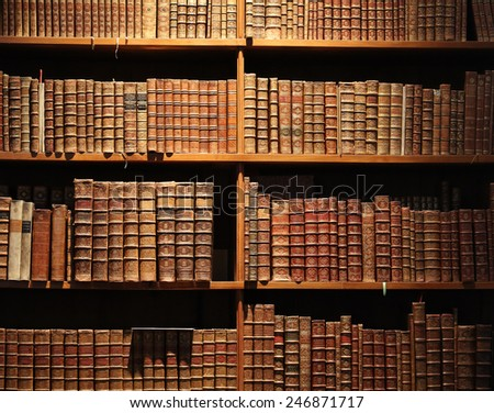 wooden bookshelf with antique books. - stock photo