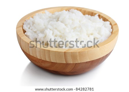 Wooden bowl of cooked rice  isolated on white - stock photo